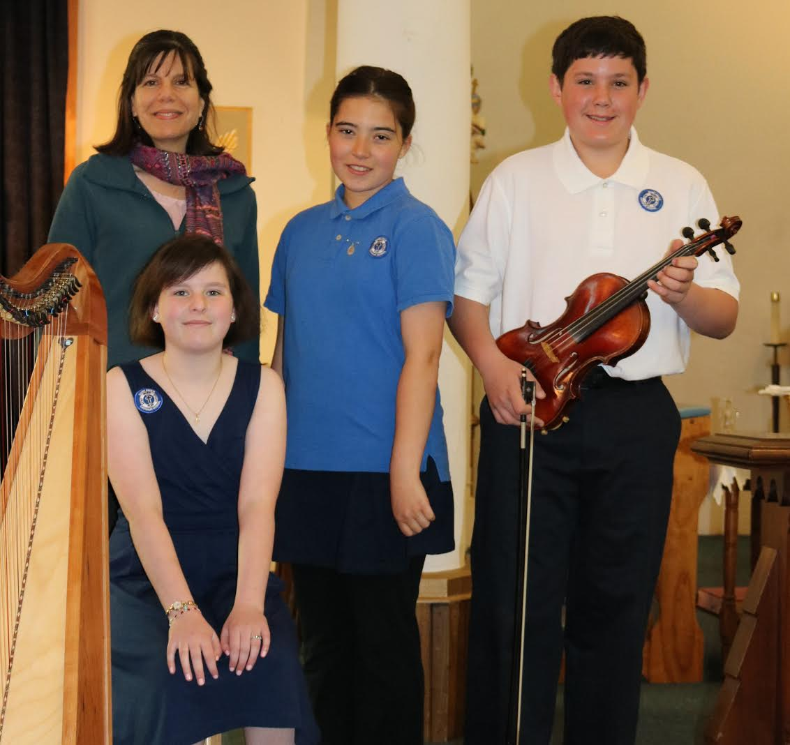 Mrs. Matthews, Isabella, Nicholas and Mary play for school Mass with Bishop Coyne.