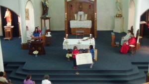 1st & 2nd graders hold psalm response.