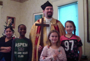 Students with St. Nicholas (Fr. Naples) at a Vocationist Christmas Party Dec. 10th.