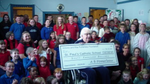 Mr. Tony Pomerleau, visited the school to bring a check for $60,000 to match funds raised for the school's 120th anniversary year.
