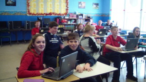 Middle School students using the 15 new laptop computers obtained from the generosity of a donor.
