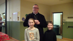 Zoey and Matthew with Bishop Coyne after the Mass for Life.