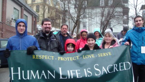 Fr. Naples, Matthew and Zoey and Zoey's grandmother Carol at the March for Life in Montpelier on Sat. Jan. 21st.