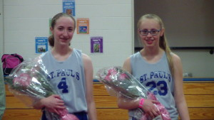 Eighth grade girls basketball players honored by Coaches at last home game.