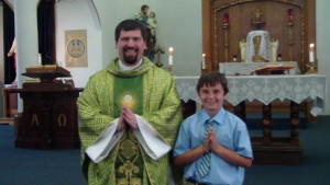 Fr. Naples and Noah after he received First Holy Communion.
